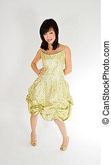 beautiful asian woman in gold dress
