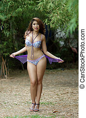 Beautiful Asian woman in lingerie voluptuous posing...