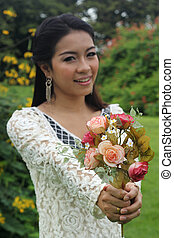 Beautiful Asian woman in love holding rose flower