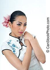 Beautiful Asian woman in Qipao
