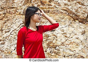 Beautiful Asian woman in red.