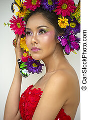 Beautiful Asian woman in red dress