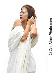 Beautiful Asian woman in white dress isolated