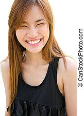 Beautiful Asian woman laughing.
