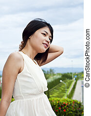 Beautiful Asian woman relaxing.