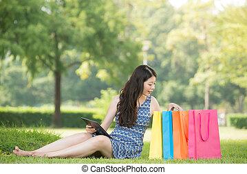 beautiful asian woman shopping online choose gift