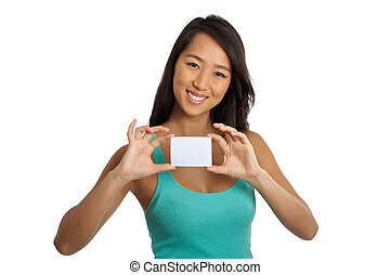 Beautiful Asian Woman showing blank paper