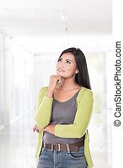 Beautiful asian woman thinking, look up