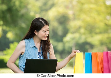 beautiful asian woman using computer shopping online