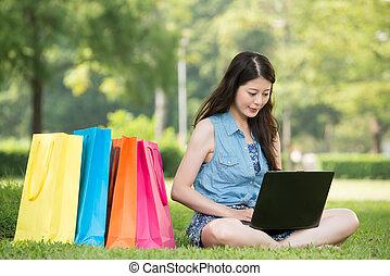 beautiful asian woman using computer shopping online