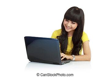 beautiful asian woman using laptop