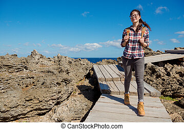 beautiful asian woman visiting national park of KenTing,...