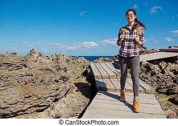 beautiful asian woman visiting national park of KenTing,...