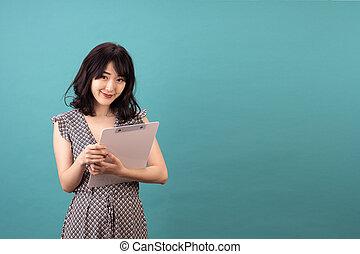 Beautiful asian woman wearing dress smiling