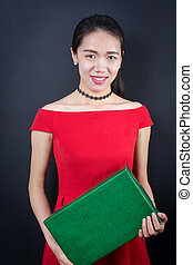 Beautiful Asian woman with a present box