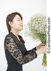 Beautiful asian woman with bouquet