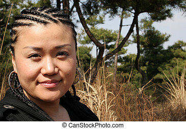 Beautiful Asian woman with braided hair