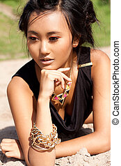 beautiful asian woman with colorful makeup on the beach