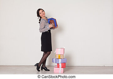 beautiful Asian woman with gifts for a birthday party