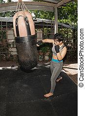 Beautiful Asian women 20-30 year old are punching sandbags ...