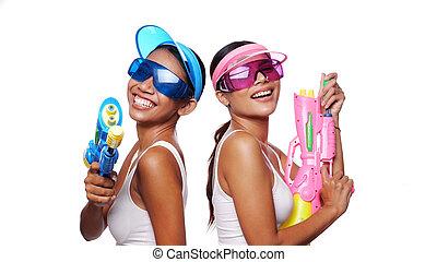 Beautiful Asian women in pink and blue sun visor cap and ...