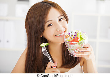 beautiful asian young woman eating healthy food