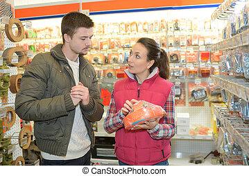 beautiful assistant seller help customer choosing equipment
