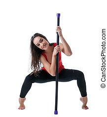 Beautiful athlete posing with fitbar in studio