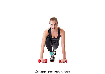 Beautiful athlete squatting with dumbbells