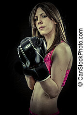 Beautiful athlete woman with boxing gloves