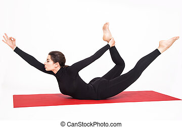 sporty beautiful young woman practicing yoga doing wide