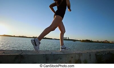 Beautiful Athletic Girl Running On The Waterfront
