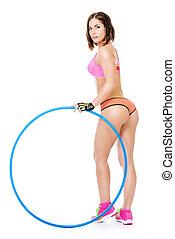 hula hoop - Beautiful athletic woman posing with hula hoop....