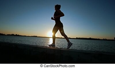 Beautiful Athletic Woman Running On The Waterfront, Slow...