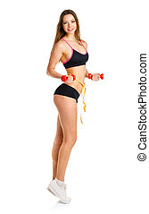 Beautiful athletic woman with dumbbells and measuring tape on wa