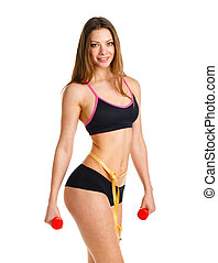 Beautiful athletic woman with dumbbells and with measuring tape