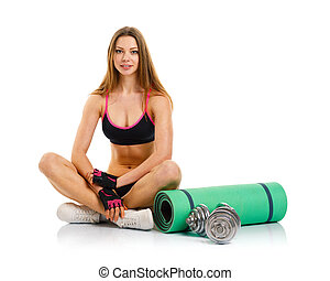 Beautiful athletic woman with dumbbells, mat for fitness sitting