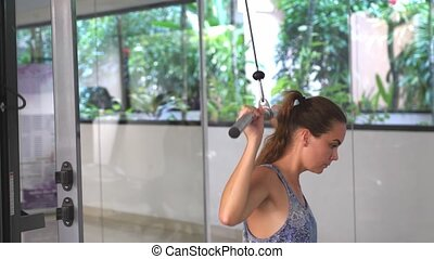 Beautiful Athletic young woman trains her back Intensive...