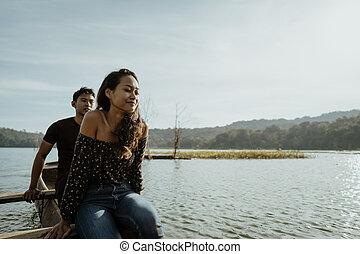 asian woman in nature enjoying