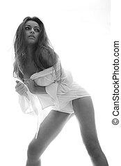 beautiful attractive female body in erotic white lingerie