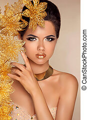 Beautiful Attractive Girl With Golden Flowers. Beauty Model Woma