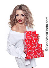Beautiful attractive woman holding red gift box isolated on white background