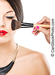Beautiful attractive woman with half face,  luxury makeup brush of his face