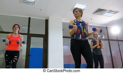 Beautiful attractive women sweating while doing fitness at the club
