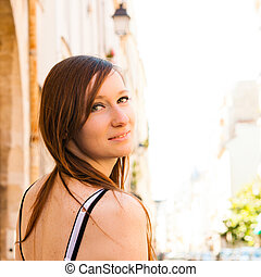 beautiful attractive young woman smiling while looking back