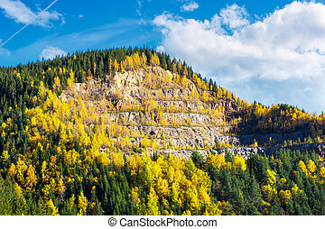 beautiful autumn background. forested hills in evening. rock...
