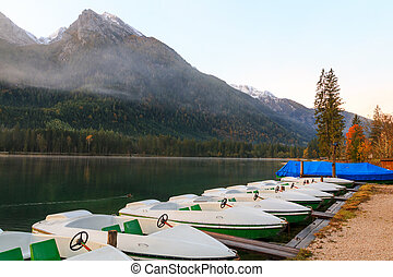 Beautiful autumn colors in the sunrise at the Hintersee lake in Bavaria alps