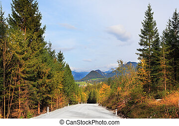 Beautiful autumn day in the Austrian Alps. Road in the...