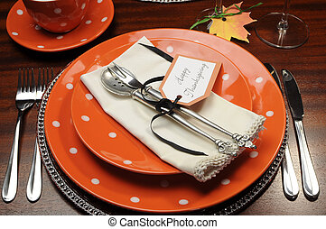 Beautiful Autumn Fall theme Thanksgiving dinner table place setting with Happy Thanksgiving tag attached to silverware.