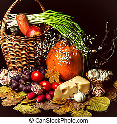 Beautiful autumn harvest of vegetables and leaves on black...